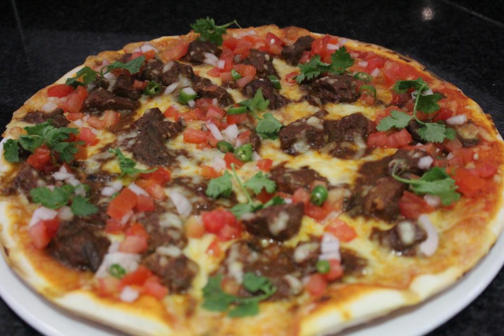 HALF PRICE ON ALL PIZZA'S